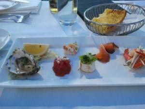 Oyster, sashimi tuna, bug meat, sushi, cured salmon, prawns & avocado mousse