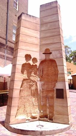 """First Impressions"" Sandstone relief sculpture symbolises the origins and settlement of the colony. Playfair Street, The Rocks, Sydney, NSW Australia"