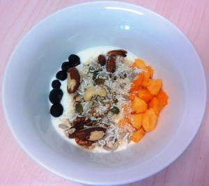 Food fight: Big Food vs Good Food. Home-made yoghurt, home-made muesli, Omaha Organic NZ frozen blueberries, peach from Sariwa farmers market stall who sourced them from the grower at Orange, NSW.