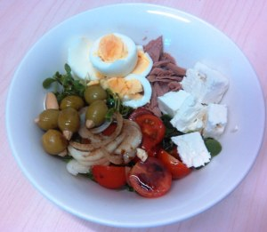 Food fight: Big Food vs Good Food. Home-made work lunch made from Good Fish tuna, farmers market salad selections, free range egg, Bulgarian sheeps milk feta, Spanish [naturally] green olives stuffed with almonds.