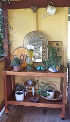 Old fashioned potted plants on the verandah