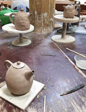Fundamentals in Clay: Teapots by my classmates.